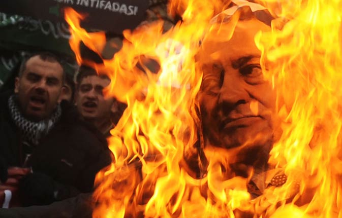 Turkish Muslims burn a picture of Egyptian President Hosni Mubarak on January 30, 2011 during a protest against his regime in front of the Egyptian consulate in Istanbul.  Embattled President Hosni Mubarak called out the army and tasked them specifically with helping police quell deadly protests in which around 50 people have been killed.