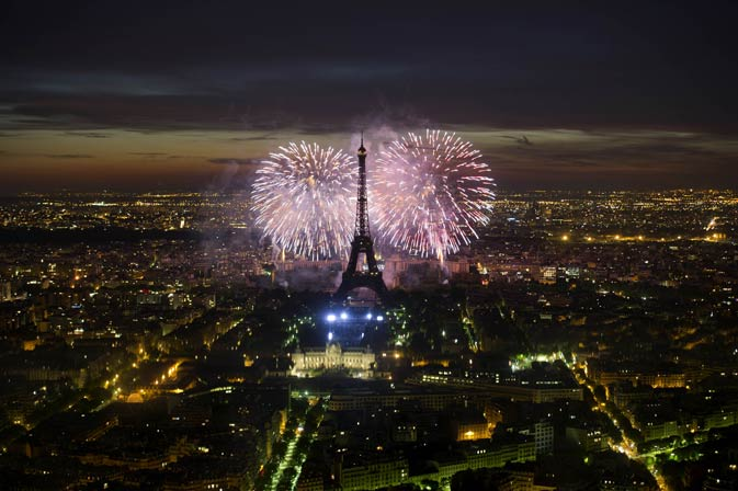 Fireworks burst over the Eiffel Tower during traditional Bastille Day celebrations on July 14, 2011 in Paris. France held  its annual military parade on the Bastille Day national holiday, haunted by the killing within the last 24 hours of six of its soldiers serving in Afghanistan.