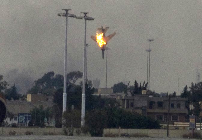 In this March 19, 2011 photo, a warplane of Gadhafi's forces is seen being shot down over the outskirts of Benghazi, eastern Libya.