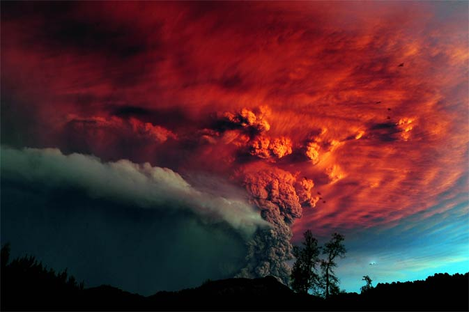 A cloud of ash billowing from Puyehue volcano near Osorno in southern Chile, 870 km south of Santiago, on June 5, 2011. Puyehue volcano erupted for the first time in half a century on June 4, 2011, prompting evacuations for 3,500 people as it sent a cloud of ash that reached Argentina. The National Service of Geology and Mining said the explosion that sparked the eruption also produced a column of gas 10 kilometers (six miles) high, hours after warning of strong seismic activity in the area.