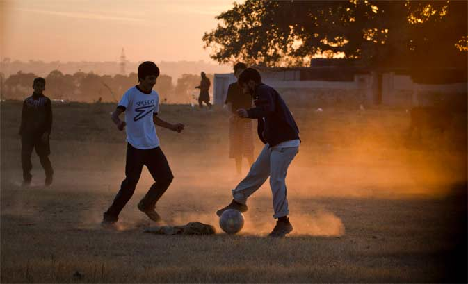 Pakistani youth are silhouetted against sunset as they play soccer at a dusty ground on the outskirts of Islamabad, Pakistan on Wednesday, Dec. 14, 2011. ? AP Photo