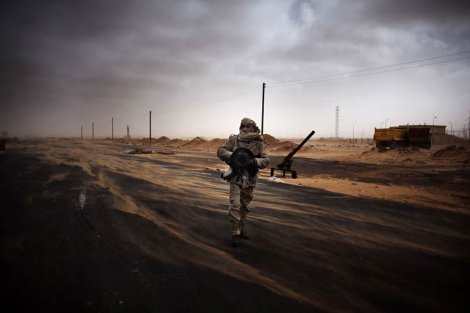 A Libyan rebel fighter mans a check point in the stronghold oil town of Ras Lanuf on March 5, 2011 where up to 10 people were killed and more than 20 wounded in clashes between opposition and loyalists of Moamer Kadhafi forces.