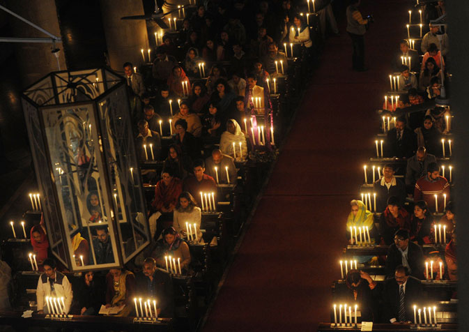 Pakistani's pray at the Cathedral church in Lahore on December 18, 2011.