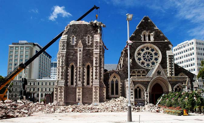 A crane lifts workers up to inspect the damaged Christchurch Cathedral in Christchurch on February 24, 2011, two days after a deadly earthquake rocked New Zealand's second city killing at least 76 people and leaving hundreds missing. A 'miracle' was required to find more survivors amid the wreckage of earthquake-hit Christchurch, Prime Minister John Key said on February 24, as the focus turned to recovering bodies.