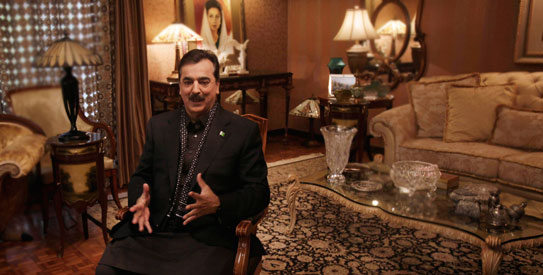 Pakistan Prime Minister Yousuf Raza Gilani, centre, gestures during an interview with The Associated Press at his residence in Lahore. —AP Photo