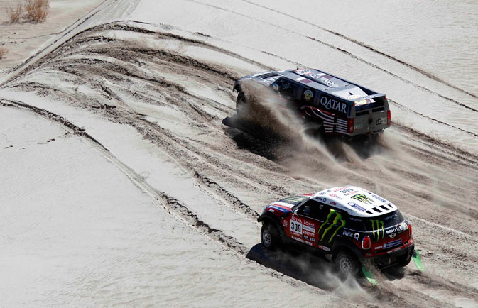 Qatar's Nasser Saleh Al-Attiyah and co-pilot Lucas Cruz of Spain, driving their Hummer, overtake Russia's Leonid Novitskiy and co-pilot Andreas Schulz of Germany in their Mini Monster during the fifth stage of the fourth South American edition of the Dakar Rally 2012 from Chilecito to Fiambala. - Reuters Photo