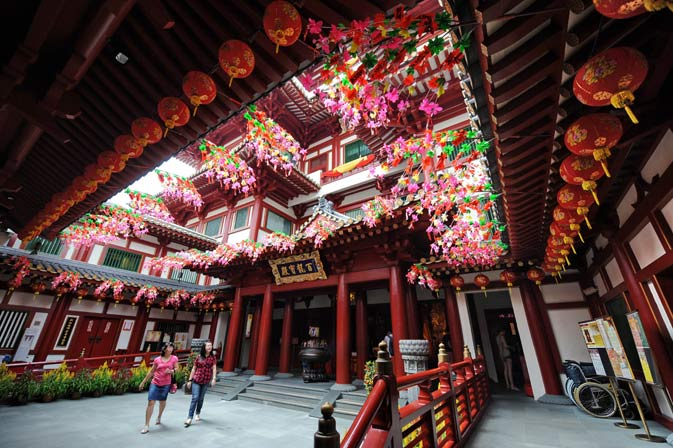 Visitors walk inside a Buddha Tooth Relic Temple and museum ahead of the Lunar New Year in Singapore on January 20, 2012. - AFP Photo