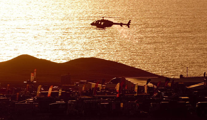 A helicopter lands in a camp during the Stage 9 of the 2012 Dakar Rally between Antofagasta and Iquique in Chile, on January 10, 2012. - AFP Photo