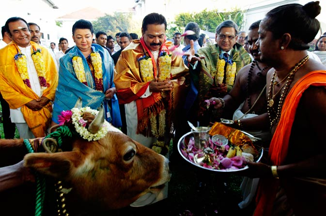 Sri Lankan President Mahinda Rajapaksa, center, Indian Foreign Minister S.M. Krishna, second right, Sri Lanka's first lady Shiranthi Rajapaksa, second left, and Prime Minister D.M. Jayaratna, left, participate in a Hindu religious rituals to celebrate Pongal festival at the president's official residence in Colombo, Sri Lanka, Monday, January 16, 2012. Krishan arrived in Sri Lanka for an official visit Monday. - AP Photo