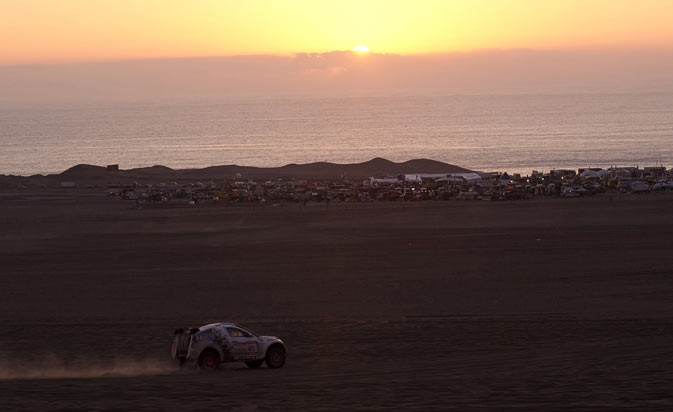 German Stefanie Manns drives his Mc Rae next to a Dakar camp during the Stage 9 of the 2012 Dakar Rally between  Antofagasta and Iquique, Chile, on January 10, 2012. - AFP PHOTO