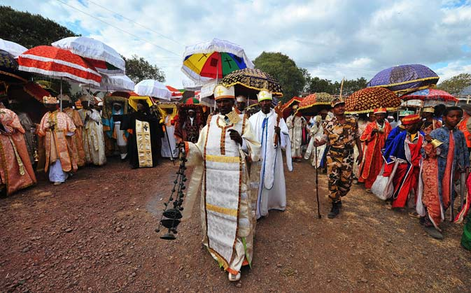 Ethiopian Orthodox Christian priests and monks take part in a procession during the annual festival of Timkat in Lalibela, on January 19, 2012. The Timkat festival marks the celebration of the Baptism of Jesus in the Jordan River. During Timkat, the Tabot, a model of the Ark of the Covenant is taken out of every Ethiopian church for 24 hours and paraded during a procession in towns across the country. Over 80 per cent of Ethiopians are estimated to be Orthodox Christians. Ethiopian Orthodox Christians believe the r