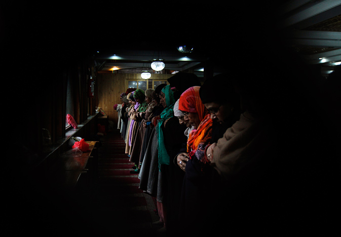 Kashmiri Muslim women offer prayers inside the shrine of Hazrat Sheikh Hamza Makhdoomi on his death anniversary in Srinagar, India, Thursday, Jan. 19, 2012. Thousands of devotees thronged the shrine on the last day of the 13-day festival. - AP Photo