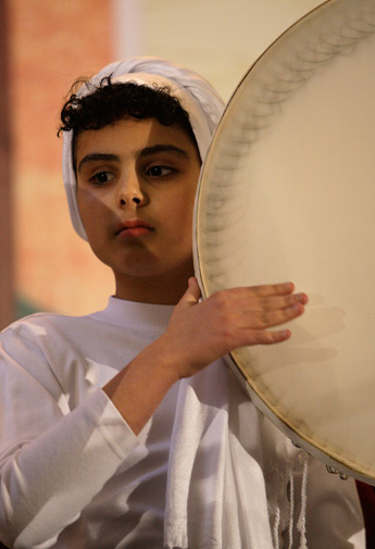 An Iranian Zoroastrian girl plays a Daf, a large-sized tambourine, during celebration of Zoroastrians ancient mid-winter Sadeh festival, outside the capital Tehran, Iran, Monday, January 30, 2012.
