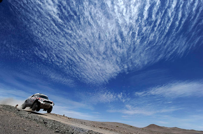 Poland's Krzystof Holowczyc and co-pilot, Belgium's Jean-Marc Fortin, drive their Mini Monster during the eight stage of the fourth South American edition of the Dakar Rally 2012 from Copiapo to Antofagasta January 9, 2012. - Reuters Photo