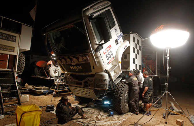 Mechanics prepare the Man truck of France's Raphael Gimbre on the eve of the eighth stage of the fourth South American edition of the Dakar Rally 2012 in Copiapo January 8, 2012. - Reuters Photo