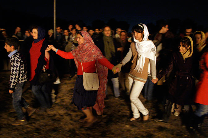 Iranian Zoroastrians join hands and form a circle around a giant bonfire, as they celebrate their ancient mid-winter Sadeh festival.