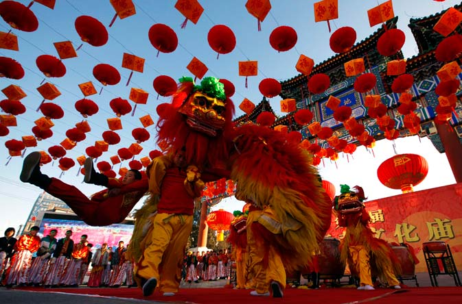 Performers wearing traditional costumes take part in a lion dance during the opening of the temple fair at Ditan Park, also known as the Temple of Earth, in Beijing January 22, 2012. - Reuters Photo