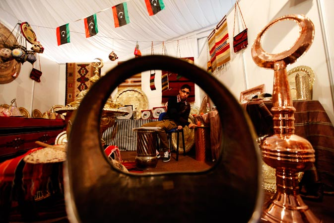 A metal worker shows his work at the Libyan Heritage Festival, organised by the Malak charity organisation, in Tripoli, January 18, 2012. - Reuters Photo