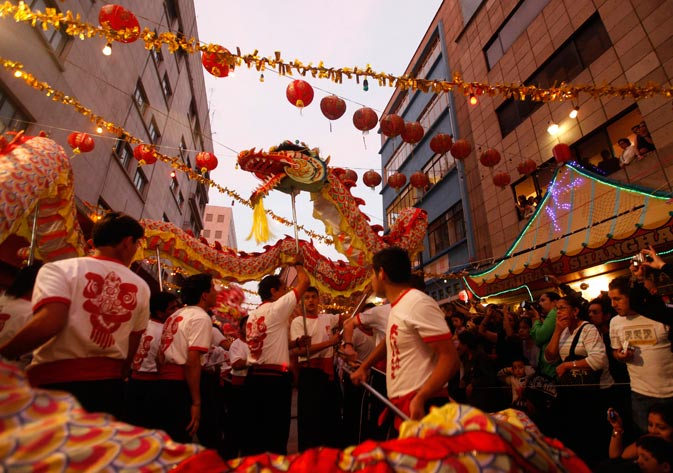People perform the traditional Chinese dragon dance during Lunar New Year celebrations in Chinatown in Mexico City January 21, 2012. - Reuters Photo