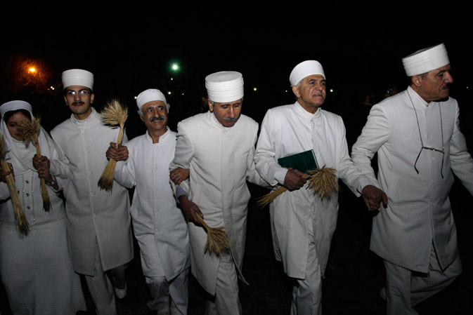 Iranian Zoroastrian priests attend their ancient mid-winter Sadeh festival, outside the capital Tehran, Iran, Monday, January 30, 2012.