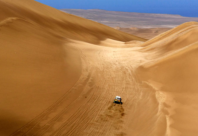 Spain's Nani Roma and co-pilot Michel Perin of France drive their Mini Monster during the 10th stage of the fourth South American edition of the Dakar Rally 2012  from Iquique to Arica January 11, 2012.- Reuters Photo