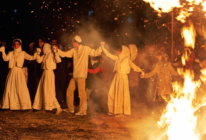Joyful Iranian Zoroastrians join hands and make a circle around a giant bonfire, as they celebrate their ancient mid-winter Sadeh festival, outside the capital Tehran, Iran, Monday, January 30, 2012.