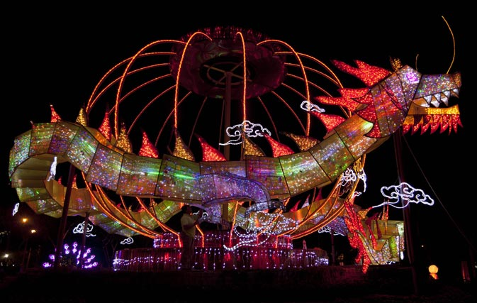 A worker inspects a dragon lantern decoration made from recycled materials and energy-saving LED lights at the Fo Guang Shan Dong Zen temple in Jenjarom, some 50 kilometres Southwest of Kuala Lumpur. - AFP Photo