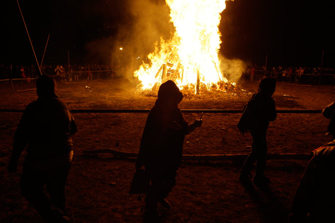 Joyful Iranian Zoroastrians join hands and make a circle around a giant bonfire, as they celebrate their ancient mid-winter Sadeh festival, outside the capital Tehran, Iran, Monday, Jan. 30, 2012.
