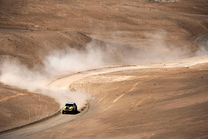 Spain's Nani Roma and co-pilot France's Michel Perin drive their Mini Monster during the 10th stage of the fourth South American edition of the Dakar Rally 2012 from Iquique to Arica January 11, 2012. - Reuters Photo