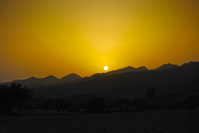 Watching the sun set through the mountains, at the Hingol national park