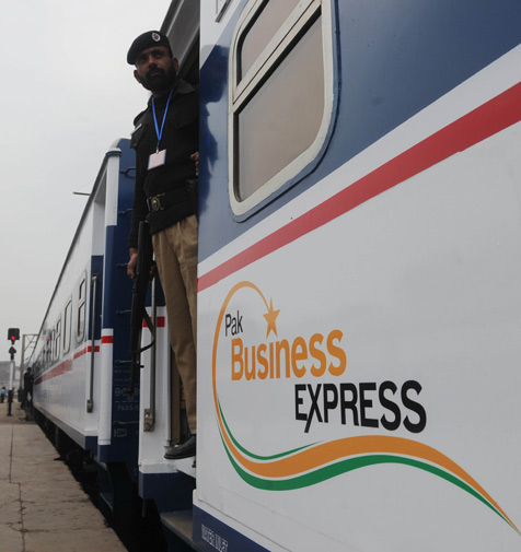 A Pakistani policeman stands guard on a newly launched Pak Business Express train prior to departure in Lahore on February 3, 2012. ? AFP Photo