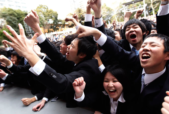 Japanese college students shout and raise their fists at a rally wishing for success in their job search in Tokyo. More than 1,000 students from business schools took part in the rally to boost their morale before their job search. ? Reuters Photo