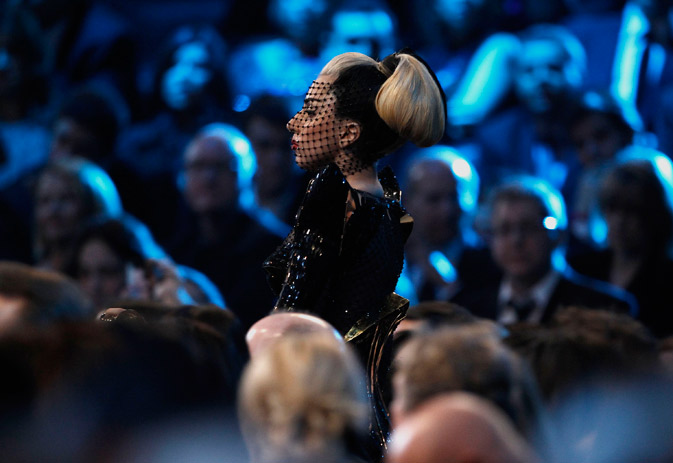 Lady Gaga stands in the audience. ? AP Photo