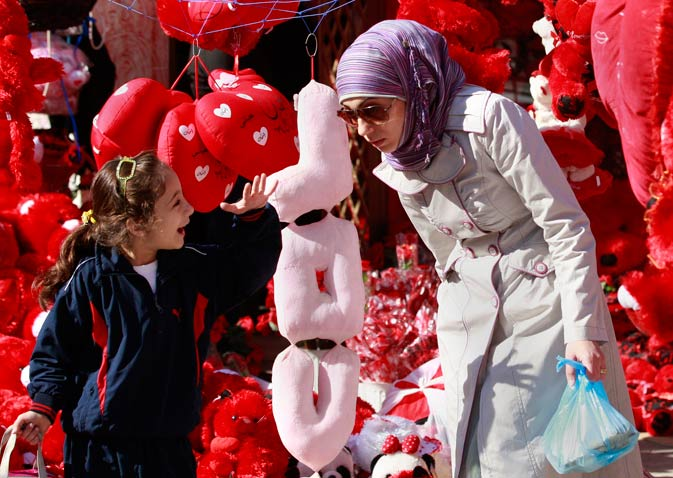 An Iraqi woman and a girl shop for Valentine's Day gifts in Baghdad, Iraq. Iraq's capital is embracing Valentine's Day this year with a huge public display of affection in what its residents say is the nation's most amorous celebration of the holiday ever. – AP Photo.