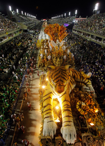 Revellers from the Porto da Pedra samba school parade on the first night of the annual Carnival parade in Rio de Janeiro's Sambadrome February 20, 2012. ? Reuters Photo