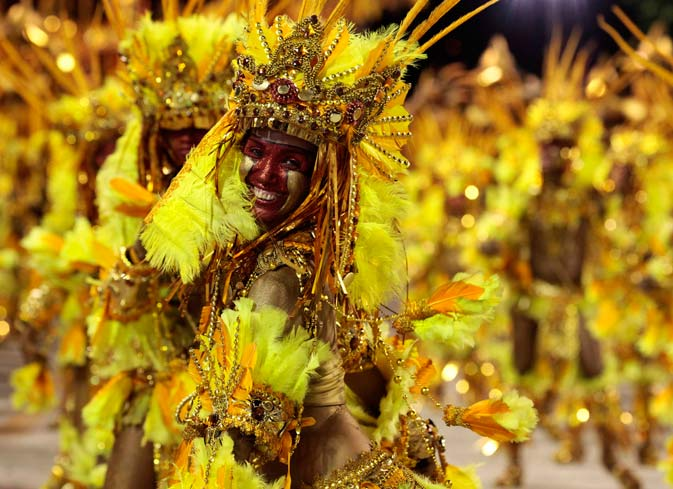 Revellers from the Beija-Flor samba school parade on the first night of the annual Carnival parade in Rio de Janeiro's Sambadrome February 20, 2012. ? Reuters Photo