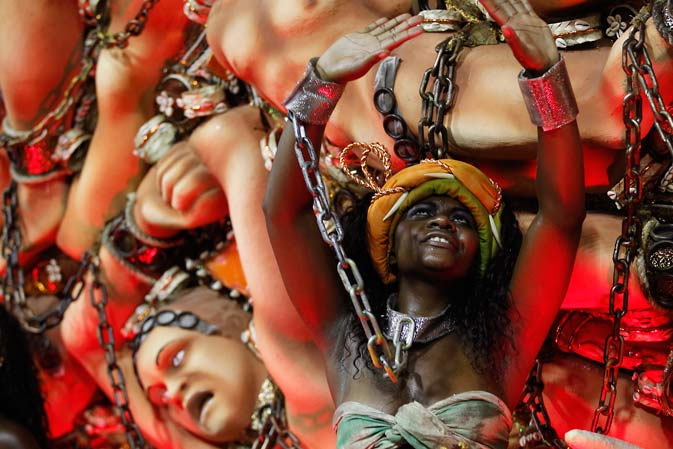 Performer from the Beija Flor samba school parades during carnival celebrations at the Sambadrome in Rio de Janeiro, Brazil, Monday, Feb. 20, 2012. Millions watched the sequin-clad samba dancers at Rio de Janeiro's iconic Carnival parade.  ?AP Photo