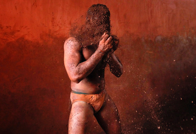 A wrestler rubs his hands with mud to prevent slipping due to sweat, during a traditional mud wrestling (Kushti) about at the Akhaara centre in Kolhapur, about 400 kms (250 miles) south of Mumbai. ? Reuters Photo
