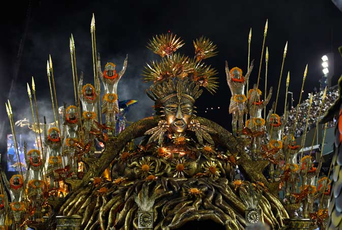 Performers from the Beija Flor samba school parade during carnival celebrations at the Sambadrome in Rio de Janeiro, Brazil, Monday, Feb. 20, 2012. Millions watched the sequin-clad samba dancers at Rio de Janeiro's iconic Carnival parade. ?AP Photo