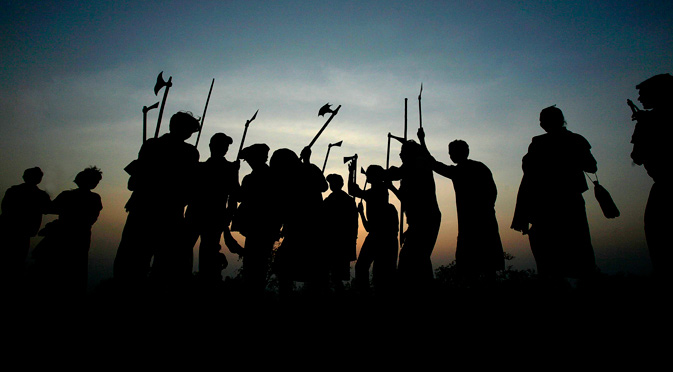 Indian Dongaria Kondh tribals dance as they hold traditional tools and weapons during the annual festival of Niyam Raja in Lanjigarh at the sacred Niyamgiri Hill, about 400 kilometers (249 miles) from the eastern Indian city of Bhubaneswar, Orissa, India. In August 2010 India refused permission to London-based Vedanta Resources to mine bauxite for its alumina refinery in the Niyamgiri Hills citing violations of environmental and human rights laws. The courts are expected to hear the company's appeal later this year