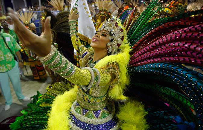 A dancer from the Imperatriz samba school sings during carnival celebrations at the Sambadrome in Rio de Janeiro, Brazil, Sunday, Feb. 19, 2012. ?AP Photo