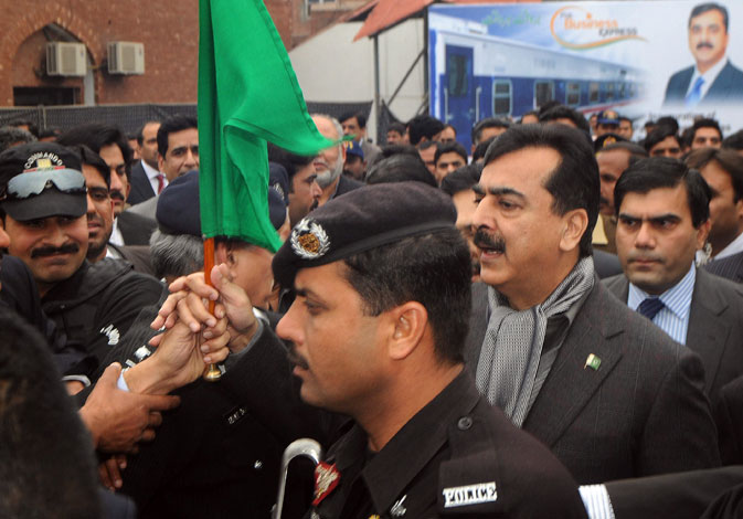 Pakistani Prime Minister Yousuf Raza Gilani (R) inaugurates a newly Pak Business Express train prior to departure in Lahore on February 3, 2012. ? AFP Photo