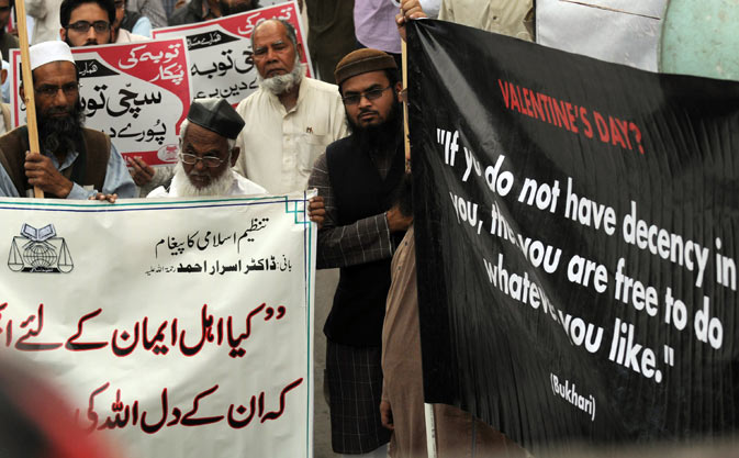 Activists of Tanzeem-e-Islami hold placards and banners during a protest against Valentine's Day in Karachi.  The holiday is increasingly celebrated in Pakistan, a Muslim country where many conservatives disapprove of the occasion as a Western import. –  AFP Photo.