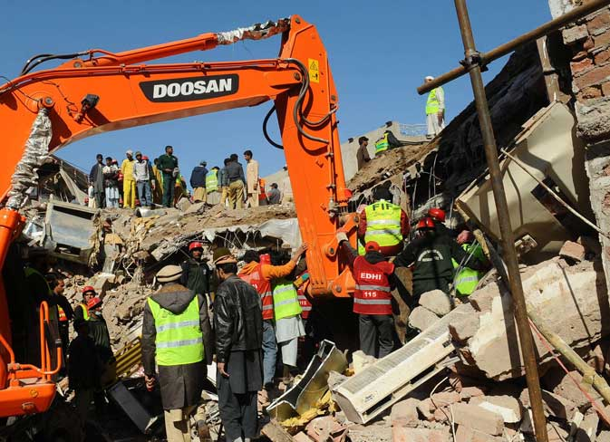 Pakistani rescue workers continue their search for victims from the debris of a collapsed building in Lahore on February 7, 2012. ? AFP Photo