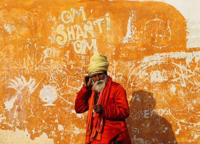 A Hindu holy man, or sadhu, basks in the sun at the Pashupatinath Temple in Kathmandu . ? Reuters Photo