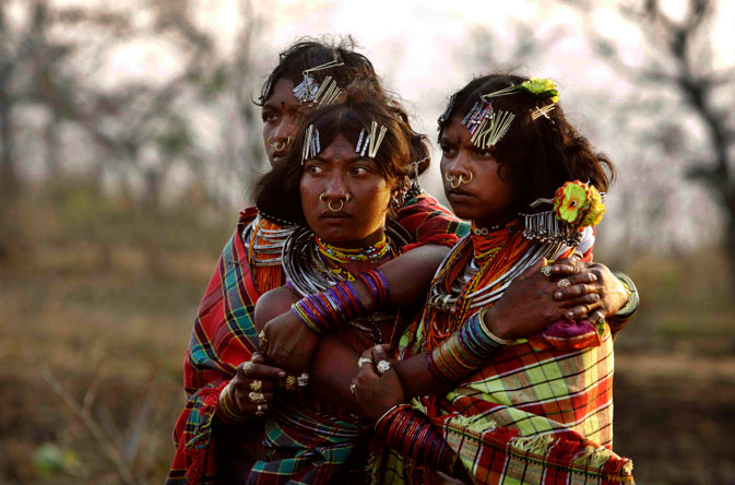 Indian Dongaria Kondh tribal girls watch sacrifice rituals during the annual festival of Niyam Raja in Lanjigarh at the sacred Niyamgiri Hill. ?AP Photo