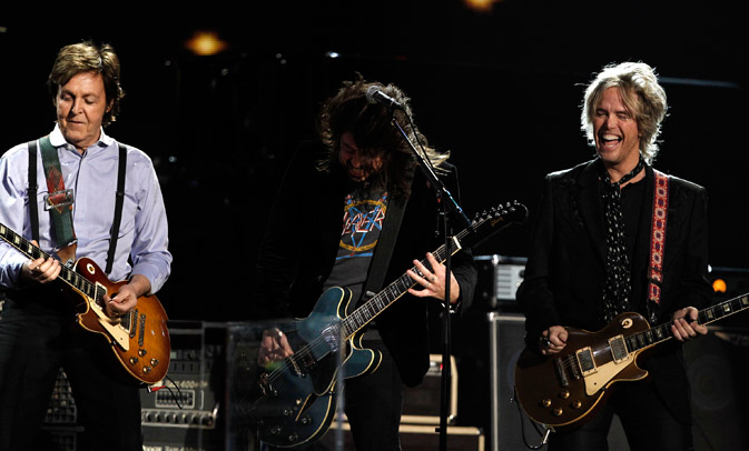 Paul McCartney, left, Dave Grohl, center, and Brian Ray perform. ? AP Photo