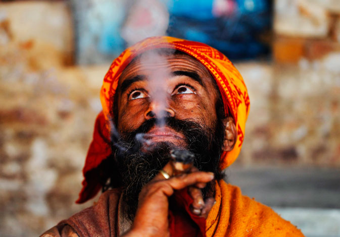 A Hindu holy man, or sadhu, smokes marijuana at Pashupatinath Temple in Kathmandu February 14, 2012. ? Reuters Photo