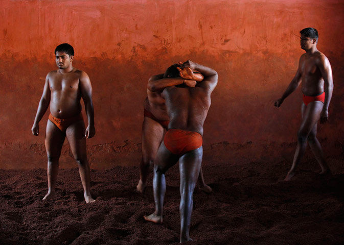 Wrestlers practise in the mud at a traditional mud wrestling (Kushti) centre called Akhaara in Kolhapur. ? Reuters Photo