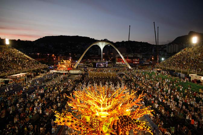 Dancers of Vila Isabel samba school parade during carnival celebrations at the Sambadrome in Rio de Janeiro, Brazil, Monday Feb. 20, 2012.   Millions watched the sequin-clad samba dancers at Rio de Janeiro's iconic Carnival parade.?AP Photo